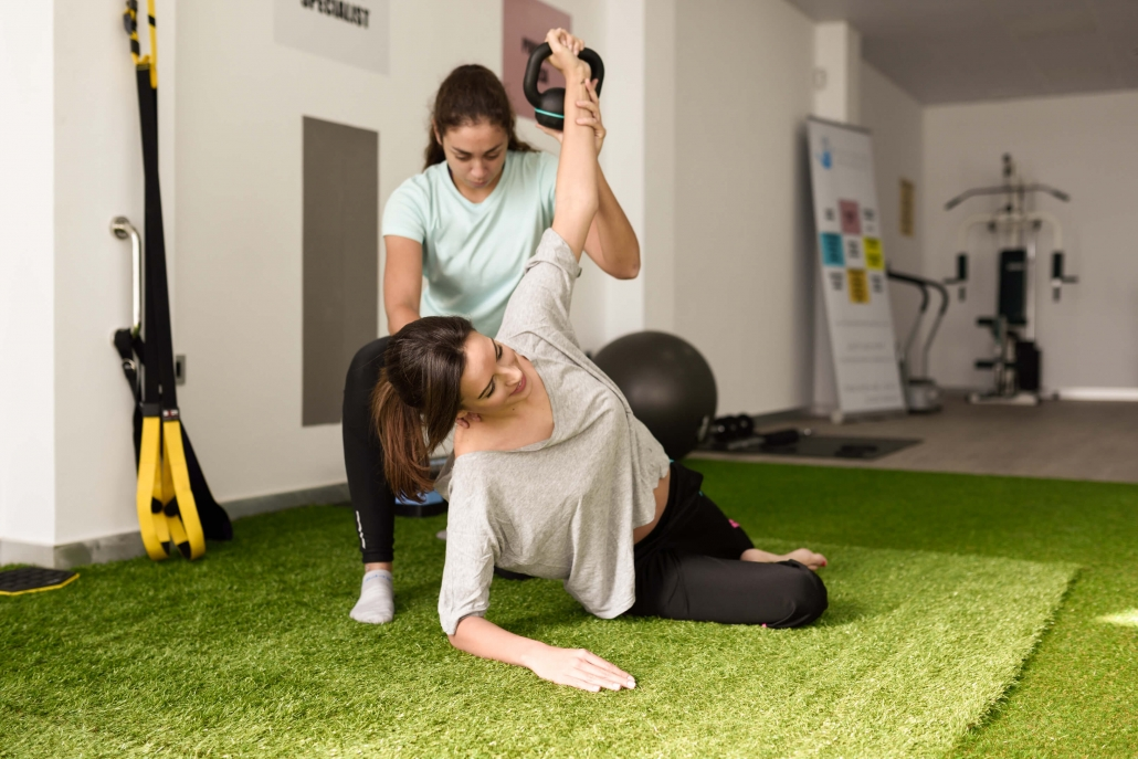 Bradenton chiropractor demonstrates rehabilitation exercises for car accident injuries