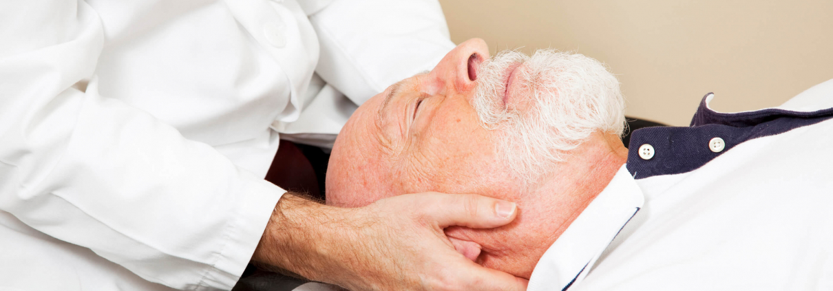 Man visits chiropractor in Bradenton for neck pain treatment